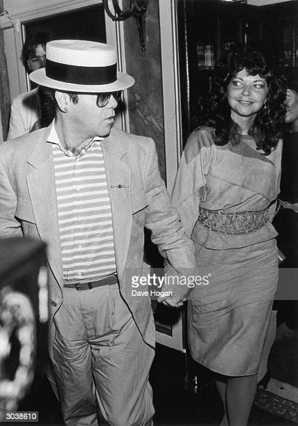British pop singer Elton John with his wife Renate Blauel circa 1985