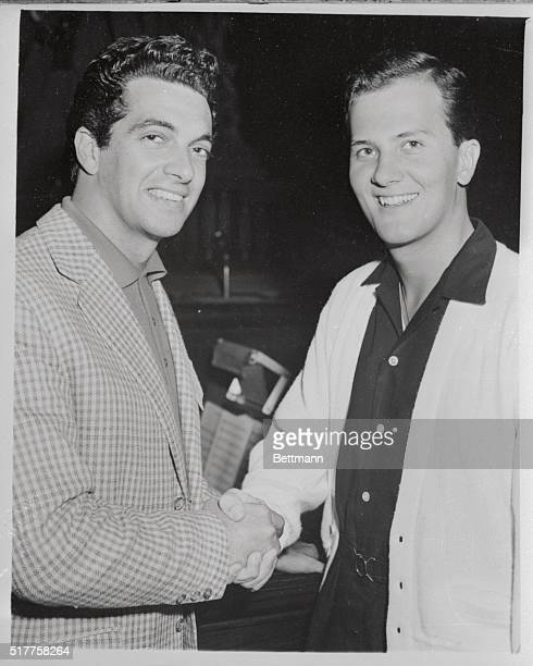 British pop singer Frankie Vaughan meets American singer pat Boone at the London Coliseum this afternoon when they were waiting to rehearse for...