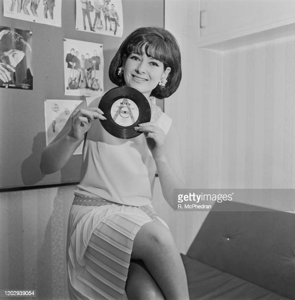 British pop singer Glenda Collins holds a promotional copy of her new HMV single record 'Johnny Loves Me' at a press reception in London on 23rd June...