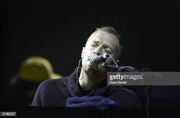 British pop star Chris Martin of the band Coldplay performs on stage at The Brit Awards 2003 held at Earl's Court Exhibition Centre on February 20...