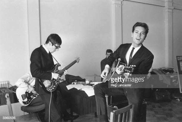 British pop star Cliff Richard rehearsing with gutarist Hank Marvin and other members of The Shadows.
