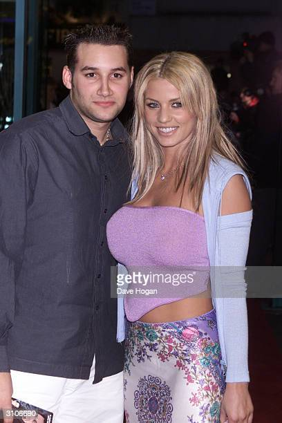 British pop star Dane Bowers and British glamour model Jordan arrive at the UK premiere of the film Any Given Sunday on March 29 2000 in London