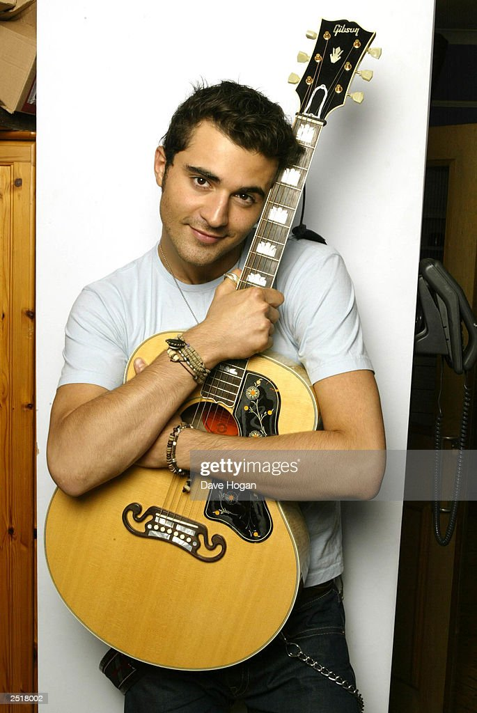 British pop star Darius Danesh poses for a promotional photoshoot prior to the launch of his new single 'Colourblind' at the London recording studio on July 28, 2002 in London.