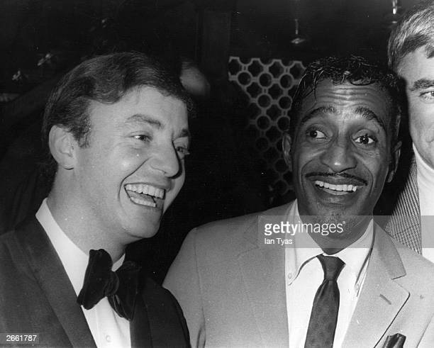 British pop star Gerry Marsden of Gerry and the Pacemakers shares a joke with American cabaret singer Sammy Davis Jnr