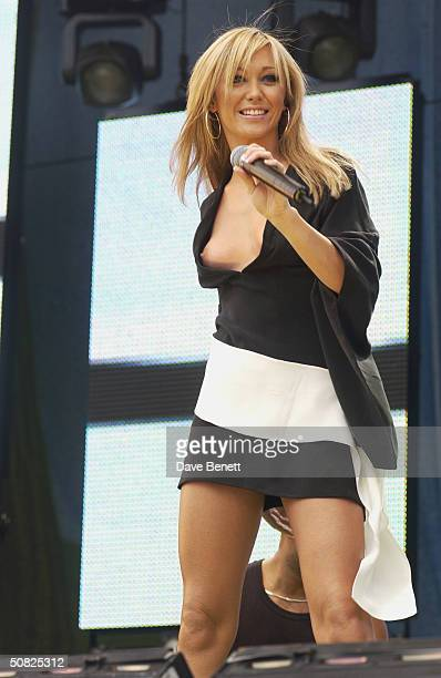 British pop star Jenny Frost of the pop group Atomic Kitten performs on stage at the Prince's Trust Party in the Park 2002 in Hyde Park on July 7...