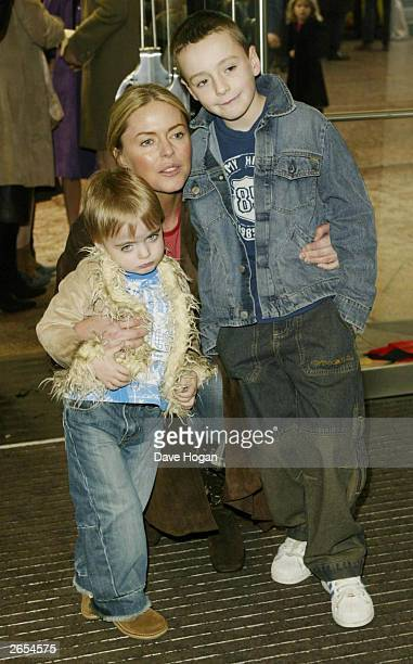 British pop star Liam Gallagher's son Lennon Francis Gallagher British actress Patsy Kensit and her other son James Kerr attend the UK film premiere...