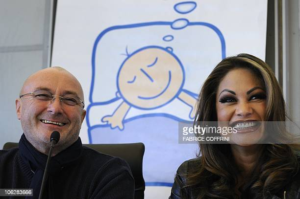 British pop star Phil Collins smiles with his exwife Orianne during a press conference on their 'Little Dreams Foundation' on October 21 2010 in Nyon...