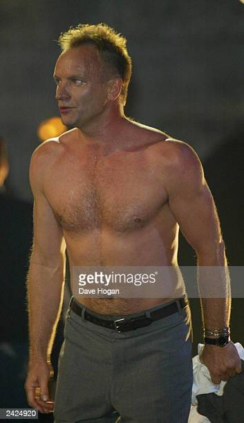 British pop star Sting performs topless on stage at the Brit Awards at Earls Court on February 20 2002 in London