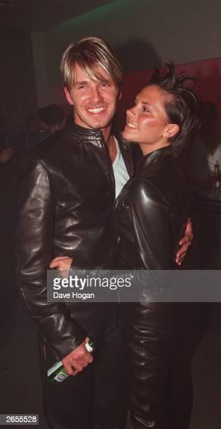 British pop star Victoria Adams and British footballer David Beckham attend the Versace store opening party in New Bond Street on June 11 1999 in...