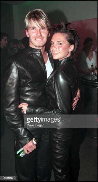 British pop star Victoria Adams and British footballer David Beckham attend the Versace store opening party in New Bond Street on June 11 1999 in...