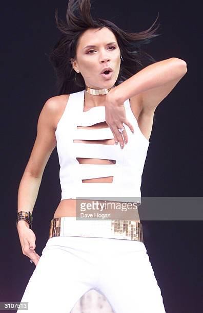 British pop star Victoria Beckham performs on stage at 'Party In The Park' held at Hyde Park on July 9 2000 in London