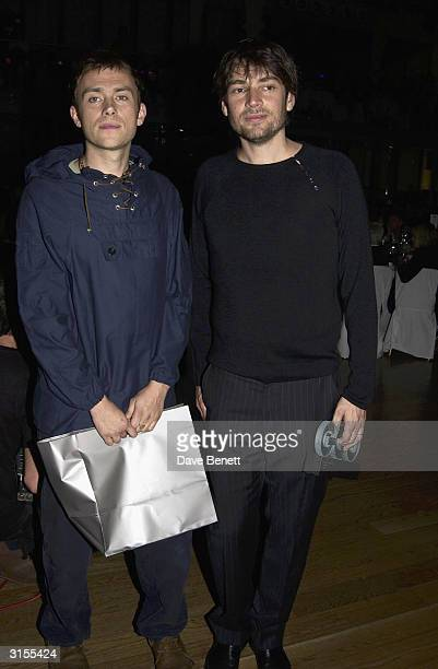 British pop stars Damon Albarn and Alex James attend the GQ Magazine 'Men of the Year Awards' held at the Floral Hall in the Royal Opera House on...
