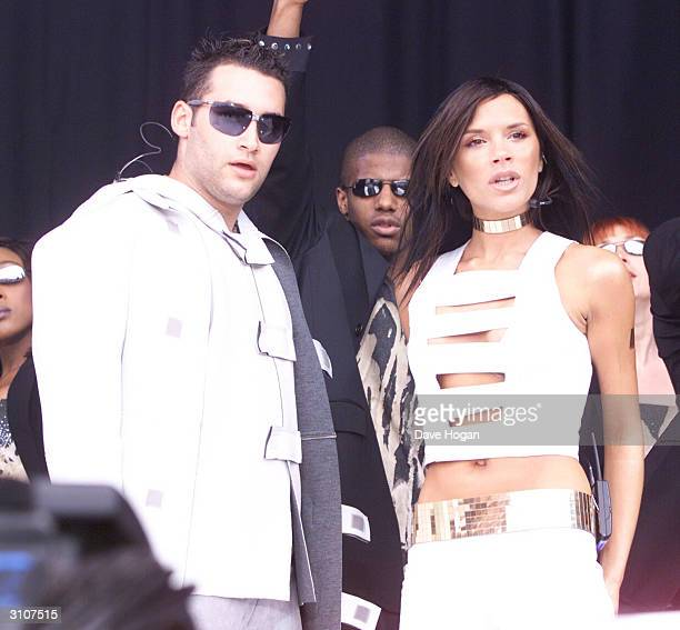 British pop stars Dane Bowers and Victoria Beckham perform on stage at 'Party In The Park' held at Hyde Park on July 9 2000 in London