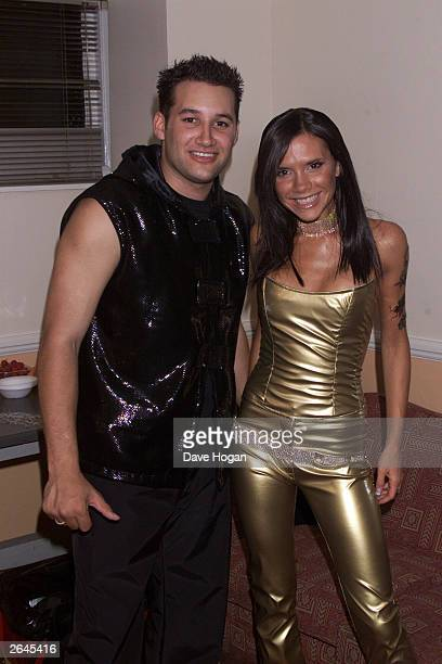 British pop stars Dane Bowers and Victoria Beckham take a break backstage at the 'GAY' night at the London Astoria on August 5 2000 in London