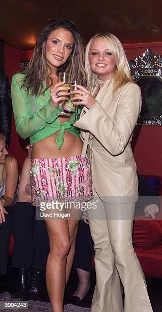 British pop stars Emma Bunton and Victoria Beckham attend the launch party for the 'Spice Girls' new album 'Forever' at the Red Cube Club on November...
