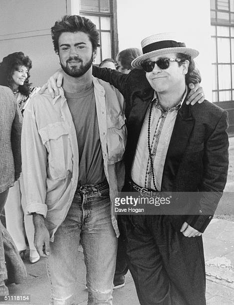British pop stars George Michael and Elton John who had recently performed at the Live Aid concert at Wembley 13th July 1985