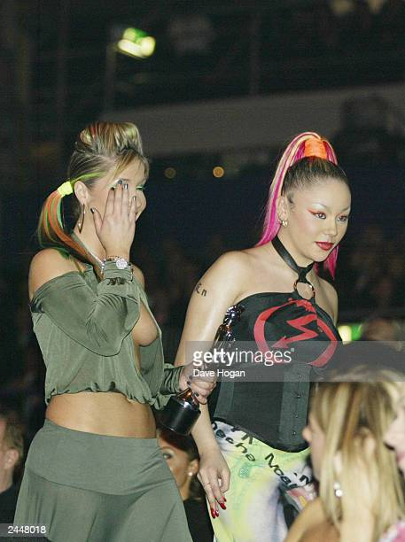 British pop stars Heidi Range and Mutya Buena of girl band Sugababes attend the Brit Awards 2003 Show at Earls Court on February 20 2003 in London