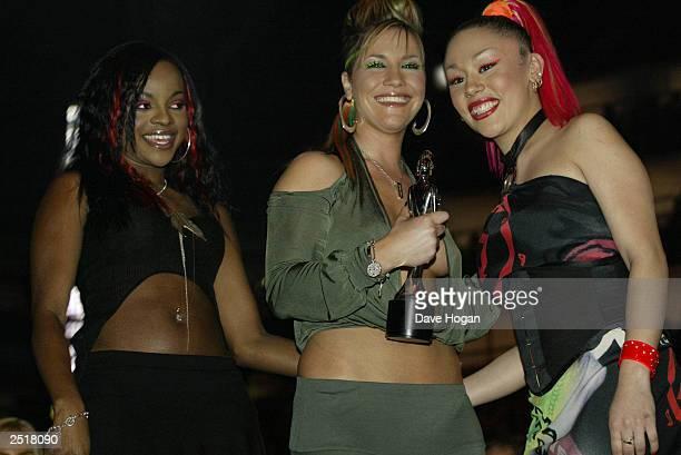 British pop stars Keisha Buchanan Heidi Range and Mutya Buena of girl band the 'Sugababes' win the award for 'Best British Dance Act' at the 2003...