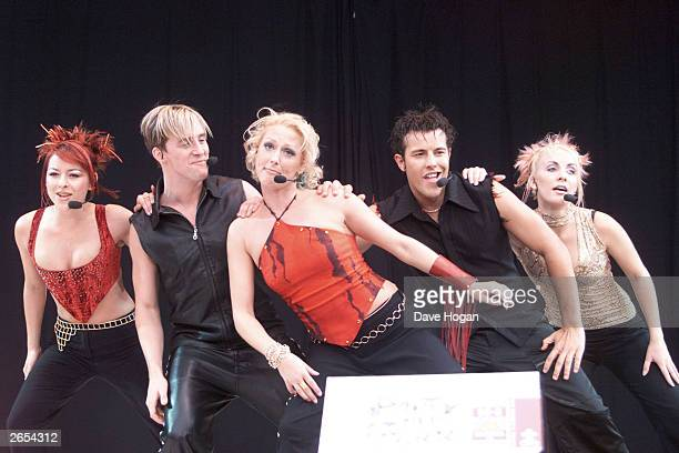 British pop stars Lisa Scott Lee Ian H Watkins Faye Tozer Lee Latchford Evans and Claire Richards of the pop group 'Steps' perform on stage at the...