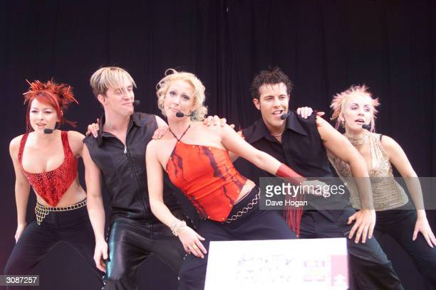 British pop stars Lisa Scott Lee Ian H Watkins Faye Tozer Lee Latchford Evans and Claire Richards of the ex pop group Steps perform on stage at Party...