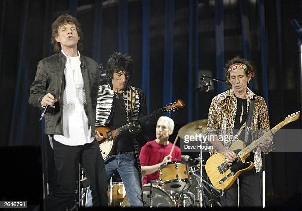 British pop stars Mick Jagger Ronnie Wood Charlie Watts and Keith Richards of the rock group The Rolling Stones perform on stage on the opening night...