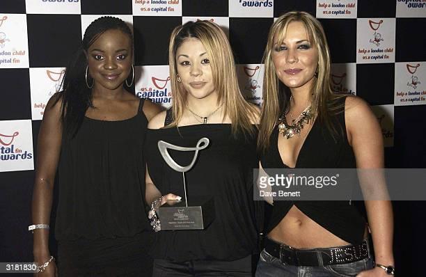 British pop stars Mutya Buena Keisha Buchanan and Heidi Range of the pop group 'Sugababes' arrive at the Capital Radio Awards held at the Royal...