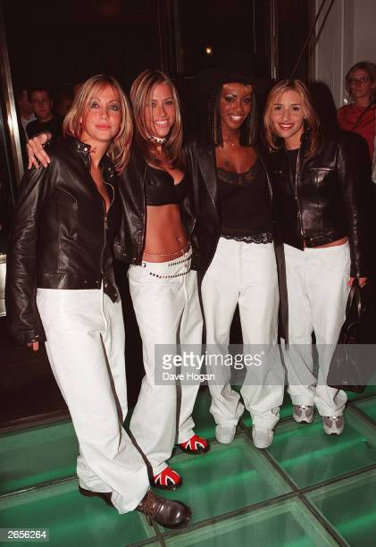 British pop stars Nicole Appleton Natalie Appleton Shaznay Lewis and Melanie Blat of the pop group All Saints arrive at the Versace store opening...