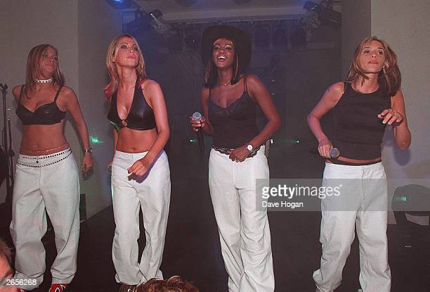 British pop stars Nicole Appleton Natalie Appleton Shaznay Lewis and Melanie Blat of the pop group All Saints perform on stage at the Versace store...