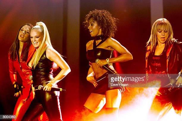 British pop stars Victoria Beckham Emma Bunton Emma Brown and Melanie Chisolm of the pop group 'Spice Girls' perform on stage at the European MTv...
