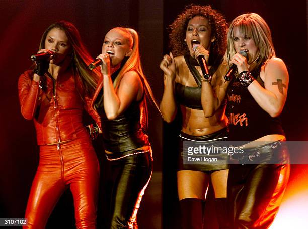 British pop stars Victoria Beckham Emma Bunton Mel Brown and Mel C of the pop group Spice Girls perform on stage at the Europe MTV Music Awards on...