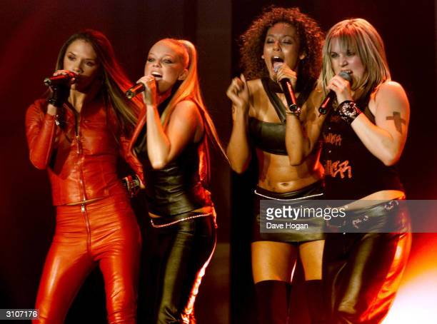 British pop stars Victoria Beckham Emma Bunton Mel Brown and 'Mel C' of the pop group 'Spice Girls' perform on stage at the Europe MTV Music Awards...