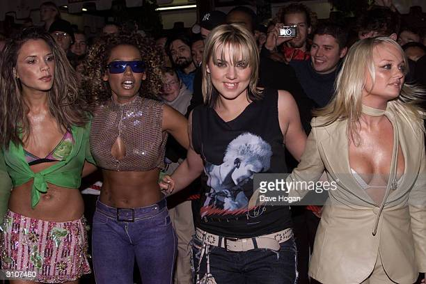 British pop stars Victoria Beckham 'Mel B' 'Mel C' and Emma Bunton of the ex pop group 'Spice Girls' attend their album launch held at the Red Cube...