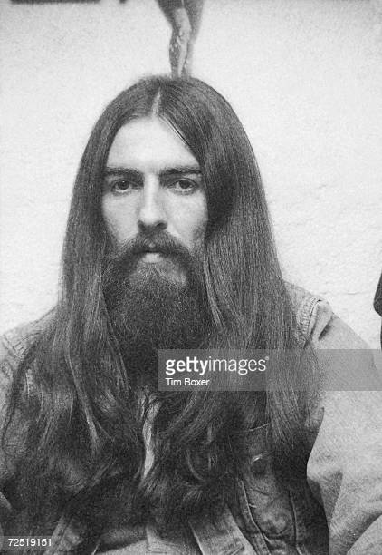 British popular rock and roll guitarist and singer George Harrison formerly of the Beatles sits for a portrait at a party 1971