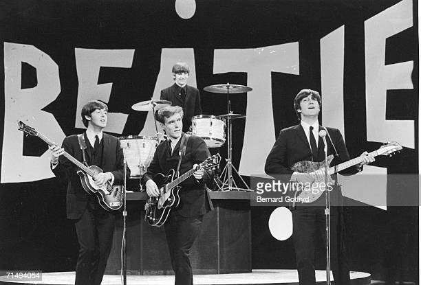 British popular rock group the Beatles perform on the set of 'The Ed Sullivan Show' New York New York February 8 1964 The band from left Paul...