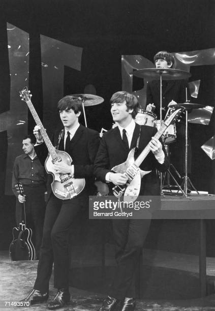 British popular rock musicians from second left Paul McCartney John Lennon and Ringo Starr of the Beatles pose on the set of 'The Ed Sullivan show'...