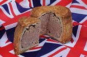 closeup whole british pork pie with