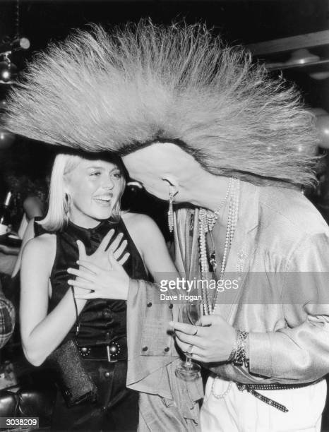 British 'Postcard punk' model Matt Belgrano greets English actress Patsy Kensit at a party to celebrate the 6th anniversary of the opening of...