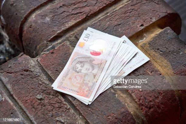 british pound banknotes, concept quarantine and recession. global economy hit by corona virus outbreak and pandemic - british pound sterling note stock pictures, royalty-free photos & images