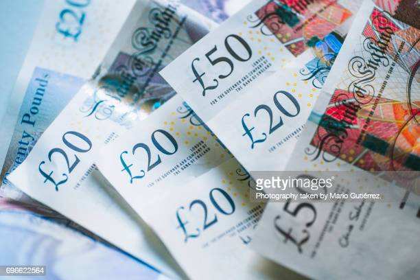 british pound banknotes - british pound sterling note stock pictures, royalty-free photos & images