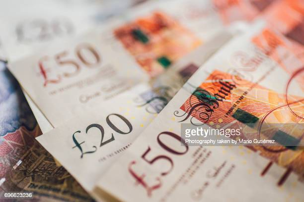 british pound banknotes - pound sterling note stock photos and pictures