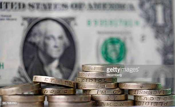 British Pound Coins And A US One Dollar Bill Are Arranged For Photograph In London