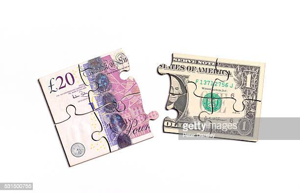 British pound note and US dollar note jigsaw