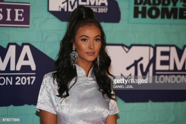 British presenter Maya Jama poses on the red carpet arriving to attend the 2017 MTV Europe Music Awards at Wembley Arena in London on November 12...