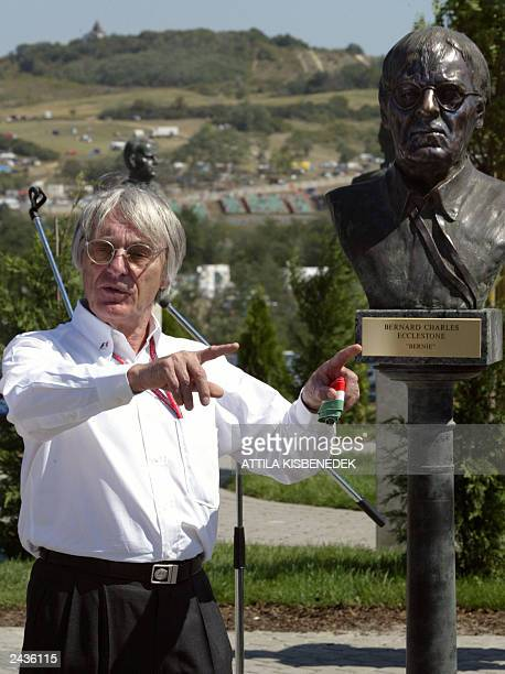 British President of tha FOA Bernie Ecclestone poses beside his statue after he inaugurated it on the Hungaroring racetrack near Budapest, 23 August...