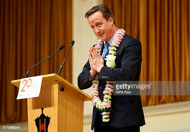 British Prime Minister and Conservative Party Leader David Cameron makes a speech during a visit to the Neasden Hindu Temple on May 2 2015 in London...