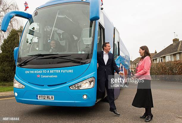 British Prime Minister and Conservative party leader David Cameron steps off the battle bus to greet Michelle Donelan Conservative Prospective Member...