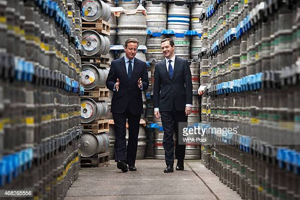 British Prime Minister and Conservative party leader David Cameron and British Finance Minister George Osborne visit the Marston's Brewery on April 1...