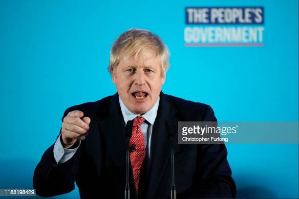 British Prime Minister and leader of the Conservative Party Boris Johnson speaks to supporters and press as the Conservatives celebrate a sweeping...