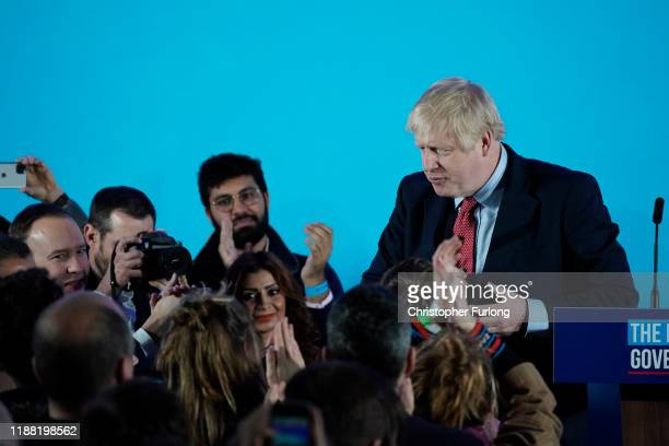 British Prime Minister and leader of the Conservative Party Boris Johnson leaves after speaking to supporters and press as the Conservatives...