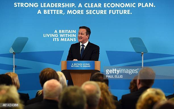 British Prime Minister and leader of the Conservative Party David Cameron delivers a speech on the ecomomy at an event in Nottingham central England...
